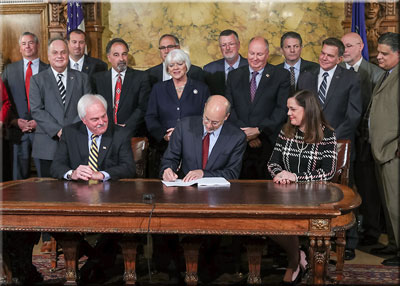 Senator Baker with Gov Wolf at bill signing