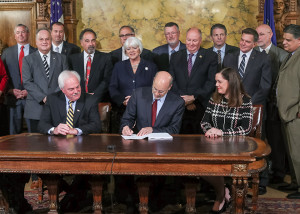 Sen. Lisa Baker looks on as Gov. Tom Wolf signs HB 319 into law on Nov. 3. Act 144 will help to ensure that seasonal workers and those who need unemployment insurance will have better and more efficient access to those funds