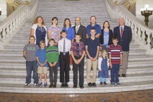 Students and their families with the Salt and Light Homeschool Support Group posed for a picture on the steps in  the Capitol Rotunda during their visit to Harrisburg.